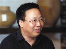 中国报商联盟秘书长陈步春照片