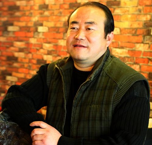 西宁乡趣园董事长鲍武章照片