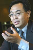 北京阳光100置业集团常务副总裁范小冲照片