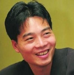 爱多企业集团董事长胡志标照片