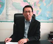 中国民用机场协会司长覃章高